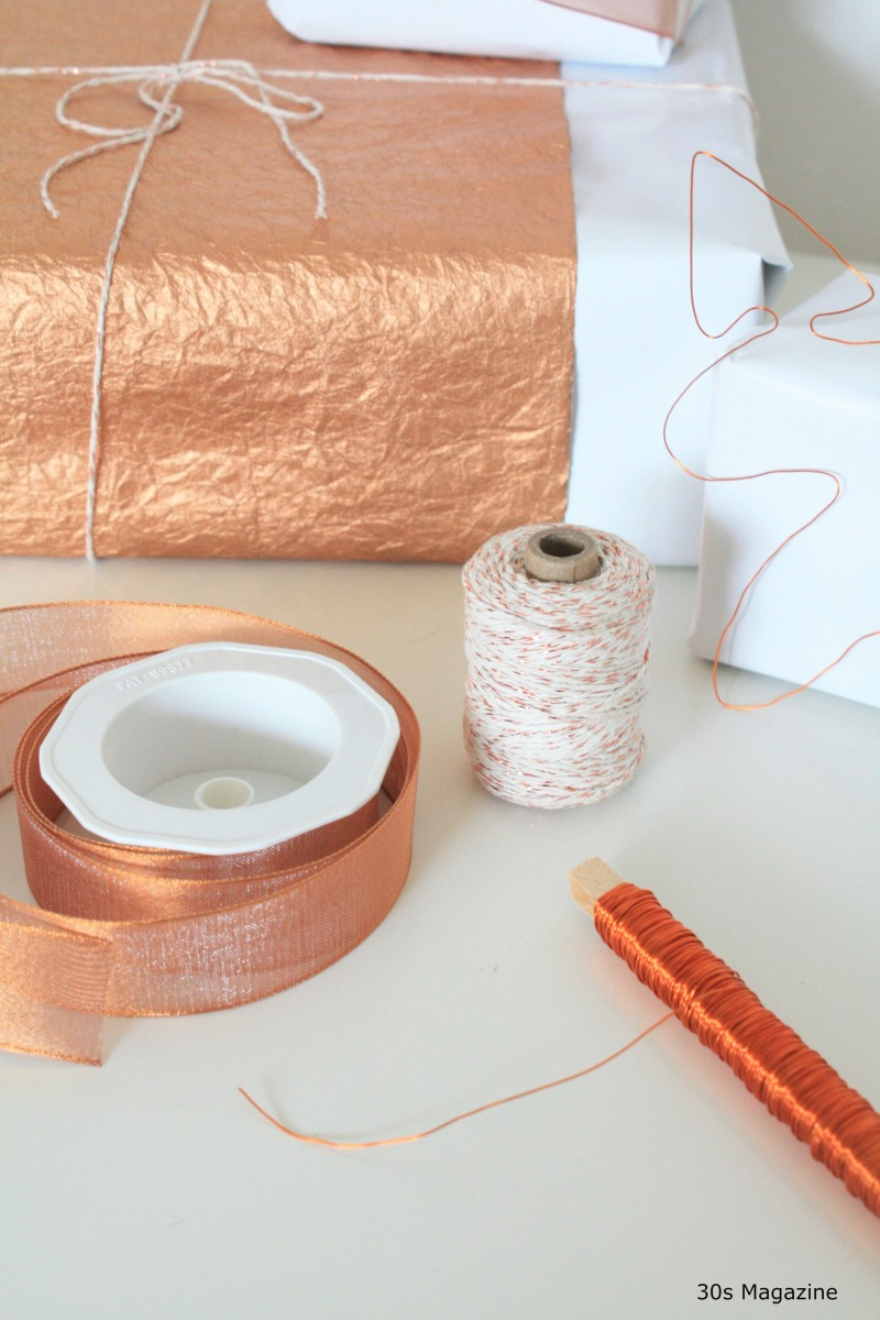Wrapping gifts in copper and white s magazine